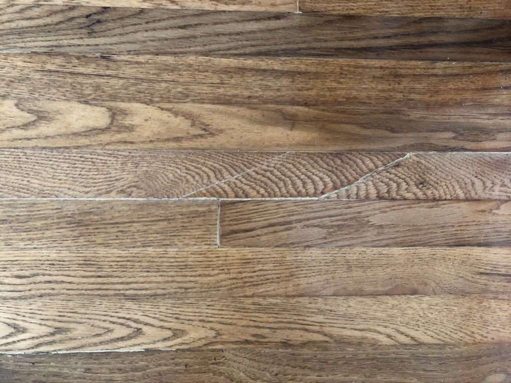 after - hardwood floors after wood filler and refinishing with water based polyurethane