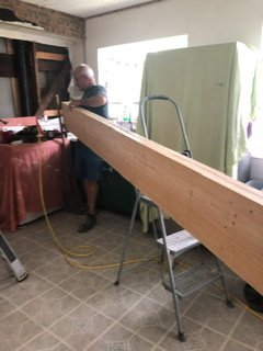 Our engineered beam to replace a load bearing wall - 2 2x12x16 southern pine boards with plywood in between